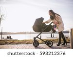 Young Mother Walking With Baby  ...