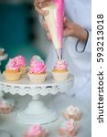 confectioner decorate cupcakes. ... | Shutterstock . vector #593213018