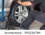 unidentified worker change tire ... | Shutterstock . vector #593236784