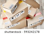 cardboard boxes on wooden floor | Shutterstock . vector #593242178
