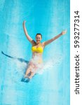 woman sliding down on water... | Shutterstock . vector #593277314