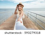 follow me. cheerful young woman ...   Shutterstock . vector #593279318