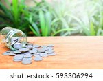 Small photo of coins take form bottle on table for background business and finance