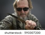 the knife in the hand of a man... | Shutterstock . vector #593307200