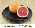 juicy red grapefruit on the... | Shutterstock . vector #593340914