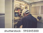 technician is measuring voltage ... | Shutterstock . vector #593345300