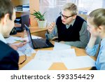 discussion of workers at the... | Shutterstock . vector #593354429