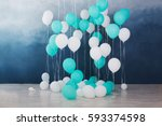 balloons on dark blue wall... | Shutterstock . vector #593374598