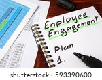 Small photo of Employee engagement written in a notebook and marker.
