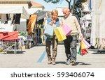 senior couple shopping together ... | Shutterstock . vector #593406074