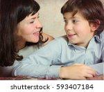 beautiful mother kiss handsome... | Shutterstock . vector #593407184