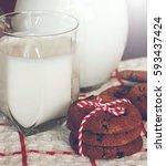 milk and cookies. | Shutterstock . vector #593437424