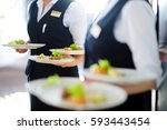waiter carrying plates with... | Shutterstock . vector #593443454