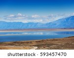 clouds reflecting in surface of ...   Shutterstock . vector #593457470