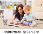 mother with child draw pencils... | Shutterstock . vector #593478470