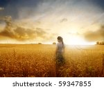 Young Woman Standing On A Whea...