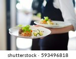 waiter carrying plates with... | Shutterstock . vector #593496818
