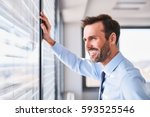 happy businessman in office... | Shutterstock . vector #593525546