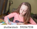 little girl drawing at home...   Shutterstock . vector #593567558
