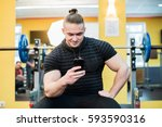 young handsome man using phone... | Shutterstock . vector #593590316