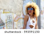 stylish afro beautiful young... | Shutterstock . vector #593591150