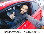 first car pic. handsome young... | Shutterstock . vector #593600018