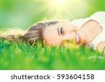 beautiful teenage girl lying on ... | Shutterstock . vector #593604158