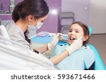 close up of pretty little girl... | Shutterstock . vector #593671466
