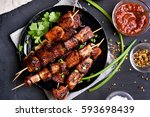 bbq meat on wooden skewers on... | Shutterstock . vector #593698439