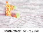 cute giraffe lying down on the... | Shutterstock . vector #593712650