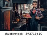 handsome bearded cook holds... | Shutterstock . vector #593719610