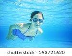 Child Swimming Underwater In A...