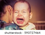mom soothes baby. the baby is... | Shutterstock . vector #593727464