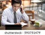 young business man working at... | Shutterstock . vector #593751479