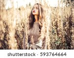 outdoor fashion photo of young... | Shutterstock . vector #593764664