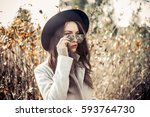outdoor fashion photo of young... | Shutterstock . vector #593764730