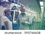 senior couple traveling inside... | Shutterstock . vector #593766638