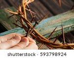 crown of thorns with hands... | Shutterstock . vector #593798924