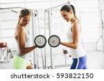 two pretty young women having... | Shutterstock . vector #593822150