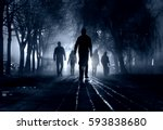 Stock photo silhouettes of people zombie walk at night in the city in the moonlight in the soft blurred focus 593838680
