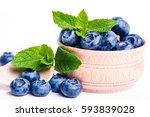 fresh sweet blueberry fruit ena ... | Shutterstock . vector #593839028