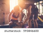 sporty girl doing weight... | Shutterstock . vector #593846600