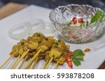 satay   chicken satay and with... | Shutterstock . vector #593878208