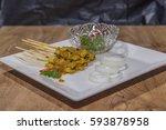 pork satay grilled pork served... | Shutterstock . vector #593878958