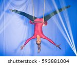trapeze women  hanging from the ... | Shutterstock . vector #593881004