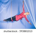 trapeze women  hanging from the ... | Shutterstock . vector #593881013