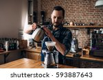 man prepares coffee in style ... | Shutterstock . vector #593887643