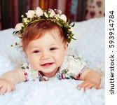 girl in flower wreath looks up... | Shutterstock . vector #593914784