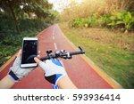 cyclist hands use gps navigator ... | Shutterstock . vector #593936414