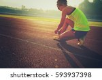 young fitness woman runner... | Shutterstock . vector #593937398